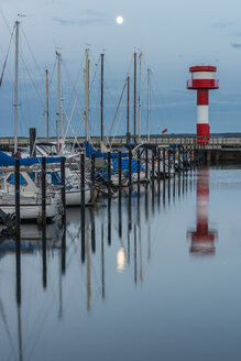 Germany, Eckernfoerde, harbor with lighthouse at full moon - KEBF000002