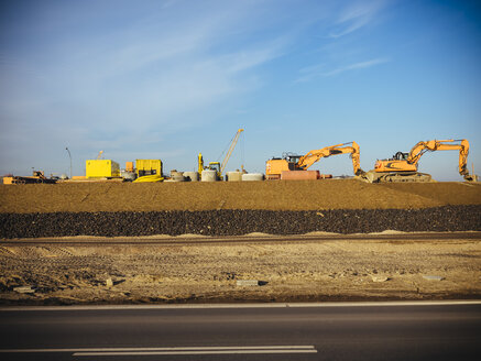 Germany, Hamburg, construction machines at roadworks - KRPF001377
