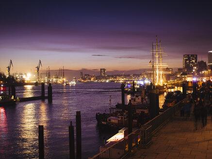 Germany, Hamburg, harbour and view of St. Pauli at night - KRPF001385