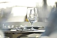 Wine glass on table in restaurant - MRF001540