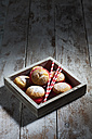 Wooden tray with muffins and drinking straws on wood - CSF024988
