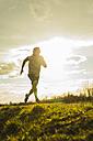 Germany, Mannheim, young man jogging - UUF003626