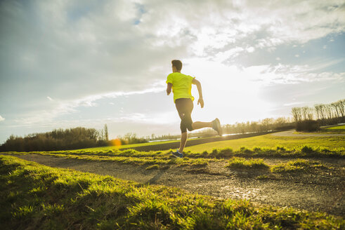 Germany, Mannheim, young man jogging - UUF003659