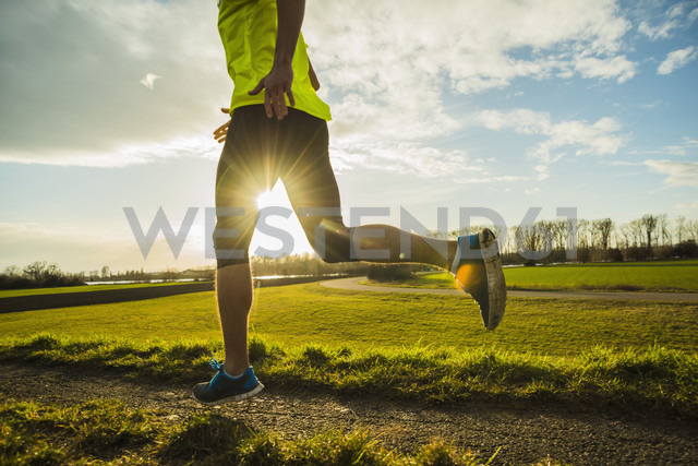 Germany, Mannheim, young man jogging - UUF003645
