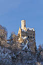 Germany, Baden Wuerttemberg, View of Lichtenstein Castle near Honau in winter - WDF002995