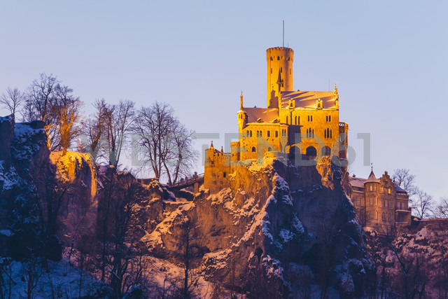 Germany, Baden Wuerttemberg, View of Lichtenstein Castle near Honau in winter, in the evening - WDF002996
