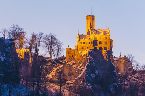 Germany, Baden Wuerttemberg, View of Lichtenstein Castle near Honau in winter, in the evening - WDF002996
