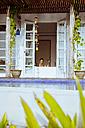 Indonesia, Bali, happy woman in bathtub - MBEF001342