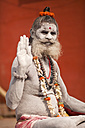 India, Uttar Pradesh, Varanasi, portrait  of a Sadhu covered with white ash - PC000103
