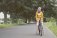 Germany, Duesseldorf, woman on bicycle - CHPF000112