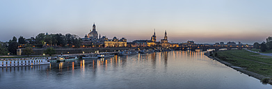 Germany, Dresden, view to lighted city with Elbe River in the foreground in the evening - PVCF000348