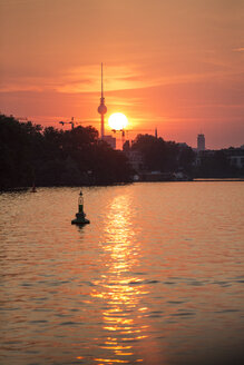 Germany, Berlin, view to Spree River at sunset with television tower in the background - ASCF000067
