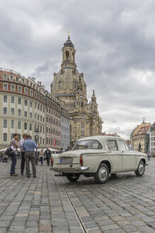 Germany, Dresden, parking Trabant with Dresden Frauenkirche in the background - PVC000333