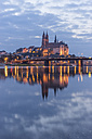 Germany, Meissen, view to lighted Albrechtsburg castle with Elbe River in the foreground - PVCF000334