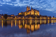 Germany, Meissen, view to lighted Albrechtsburg castle with Elbe River in the foreground - PVCF000340