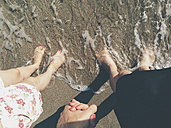 Couple stepping into the sea sand - BZF000076