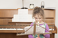Girl at music stand playing recorder - OPF000052