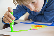 Boy painting with brush pen - SARF001549