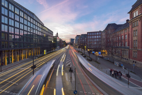 Germany, Hamburg, view to Willy-Brandt-Strasse with light trails at twilight - RJF000414