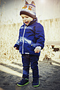 Germany, Oberhausen, toddler standing in sand - GDF000703
