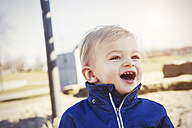 Germany, Oberhausen, toddler with open mouth on playground - GDF000700