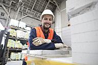 Smiling warehouseman in storehouse - SGF001422