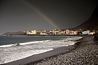 Spain, Canary Islands, La Gomera, Valle Gran Rey, Rainbow over beach and village Playa - PCF000118