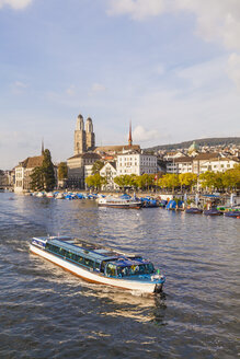 Switzerland, Zurich, view of city with tourboat on Limmat in the foreground - WD003030