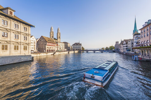 Switzerland, Zurich, view of city with tourboat on Limmat in the foreground - WD003034