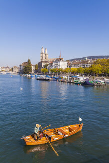 Switzerland, Zurich, view to city with fishing boat on Limmat in the foreground - WD003041