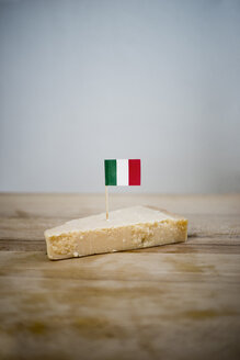 Parmesan cheese with small italian flag on wood - CHPF000123