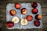 Red apples on tray and dark wood - SARF001580