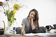 Young woman signing contract - RHF000709