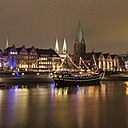 Germany, Bremen, view to lighted historic old town at night - WIF001625