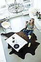 Woman hearing music with headphones at home - MAEF010051