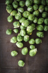 Brussels sprouts on dark wood - EVG001589