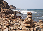 Spain, Balearic Islands, Menorca, Pile of stones on the coast of Menorca, area of red soil - RAEF000106