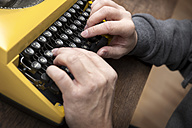 Hands typing on old typewriter - MIDF000224