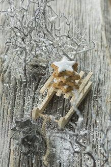 Stack of cinnamon stars on miniature sledge - ASF005520