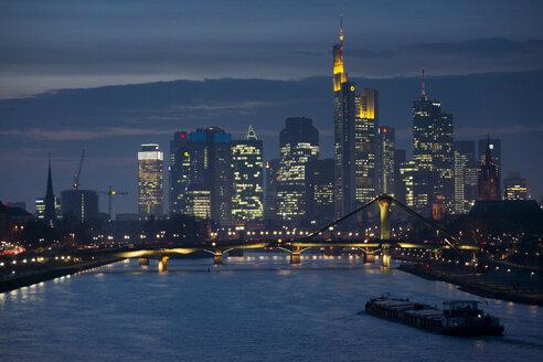 Germany, Frankfurt, River Main with Ignatz Bubis Bridge, skyline of finanial district in background - JWAF000270