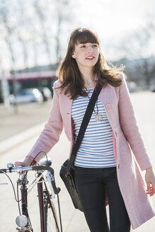 Young woman with bicycle in the city - UUF003809