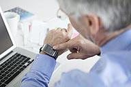 Businessman using smartwatch - RBF002578