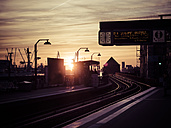 Germany, Hamburg, underground station Baumwall at sunset, Port of Hamburg in the background - KRP001416