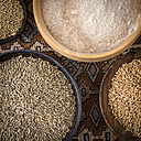Bowls of spelt grains, rye grains, buckwheat grains and whole grain wheat flour - DISF001467