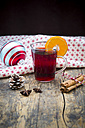 Glass of mulled wine, christmas bauble, cloth, cinnamon sticks and cinnamon stars - LVF003119