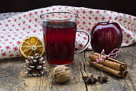 Glass of mulled wine, apple, cloth, walnut, cinnamon sticks and cinnamon stars - LVF003122