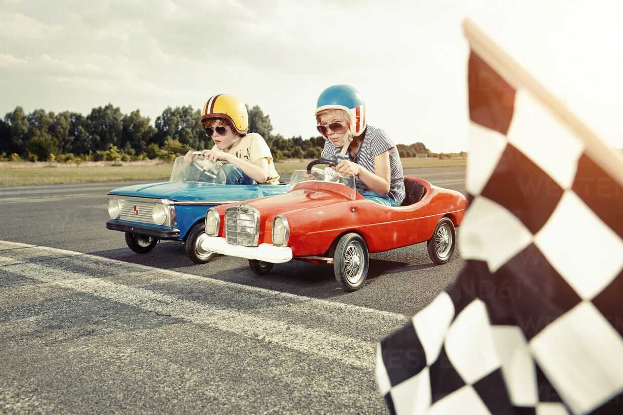 Two boys in pedal cars crossing finishing line on race track - EDF000159 - Rik Rey/Westend61