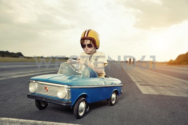Boy in pedal car on race track - EDF000165