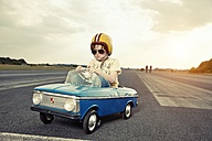 Boy in pedal car on race track - EDF000165