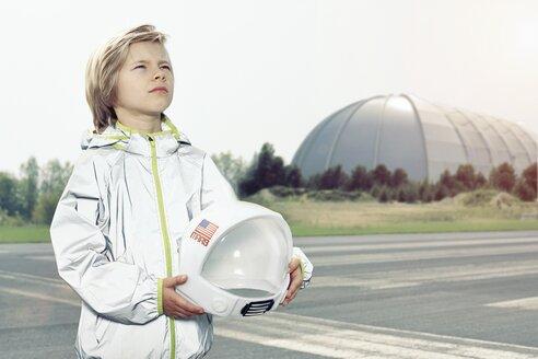 Boy dressed up as spaceman looking up - EDF000151